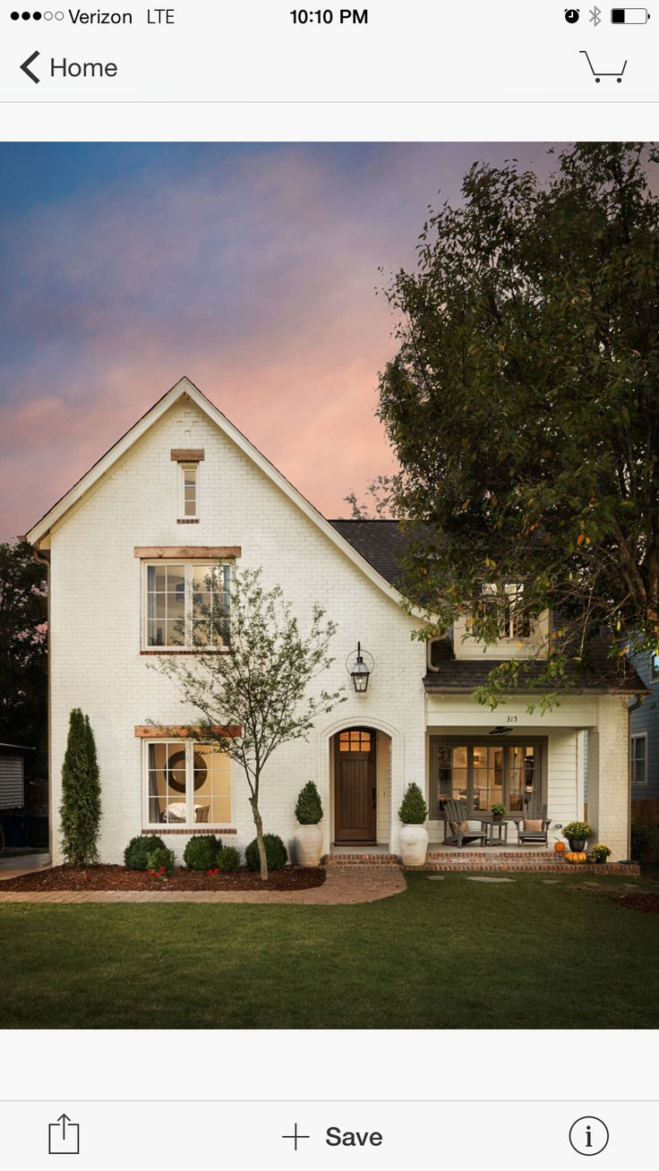 LOVE... painted brick with brick path & porch, white pots, natural wood window trim.
