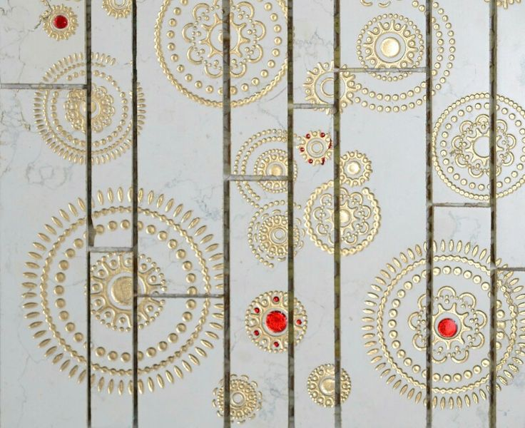 Golden details on marble mosaics