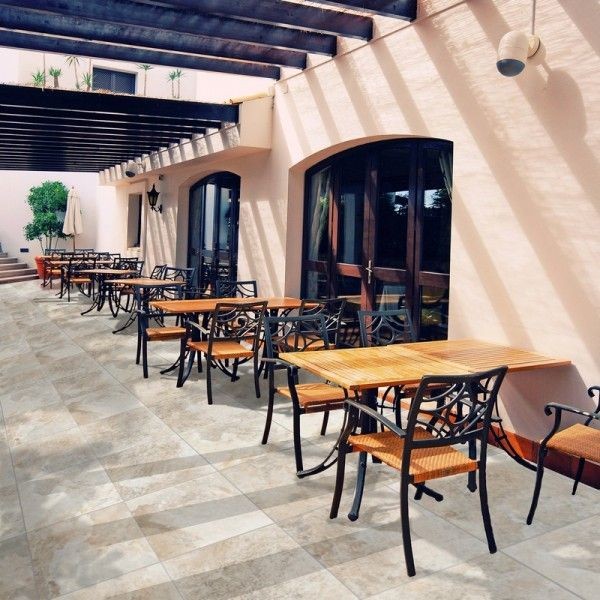 A touch of Tuscany? This outdoor area is lifted by this interesting tile choice