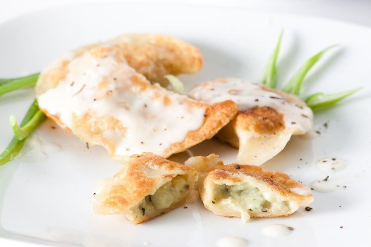 Baked dumplings stuffed with potato - pesto filling