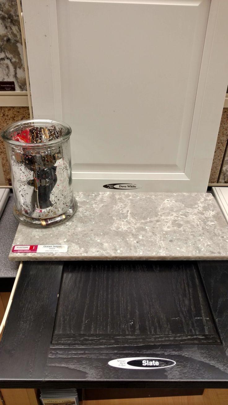 White cabinets with a black island Silestone quartz in