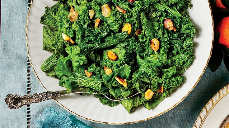 You won't have a hard time getting a Southerner to eat their vegetables when you're serving mustard or collard greens. This super fresh, garlicky, lemony mustard green recipe is the perfect mustard green recipe you've been waiting for your whole life. Coated in light olive oil and sautéed with plenty of garlic, red pepper, salt, and pepper, these mustard greens pick up a ton of fresh flavor that compliment rich holiday menus like no other. Low on fat but remarkably high on flavor, this dish…