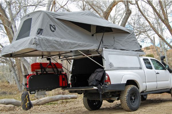Camping Shell What it is: The Tacoma Habitat Shell from AT Overland Equipment features a 15-foot-long tent—it's both waterproof and breathable—and has a self-supporting sleeping area for two. Expect 7 feet of headroom when you're standing in the bed of the truck. Additionally, the platform acts as an awning at the rear of the truck, and built-in roof load bars are on an adjustable track for carrying kayaks. It's available for Toyota Tacomas with 5 or 6-foot beds. How much: Starts at $7,299