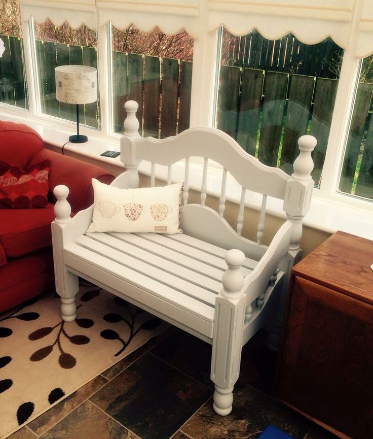 garden bench made from a single wooden bed frame painted in light blue wood