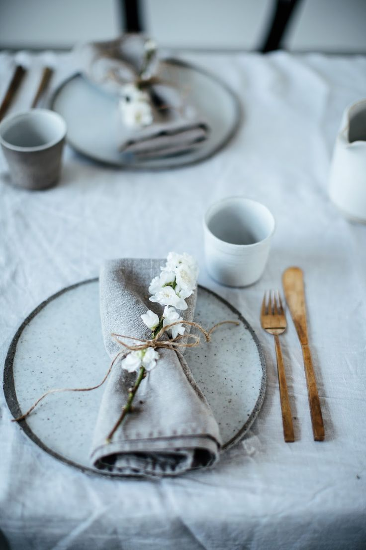 hand thrown ceramic plates and brass flatware.