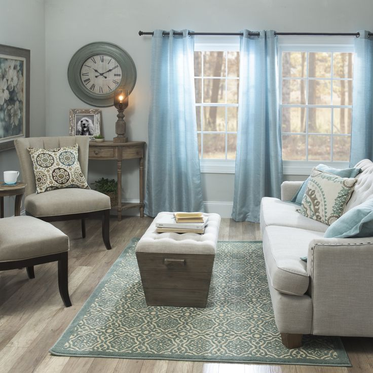Hues of blue and natural woods are a beautiful, complementing combination. Rather than going overboard with one color, we recommend finding two that pair well together and sprinkling those throughout the room.