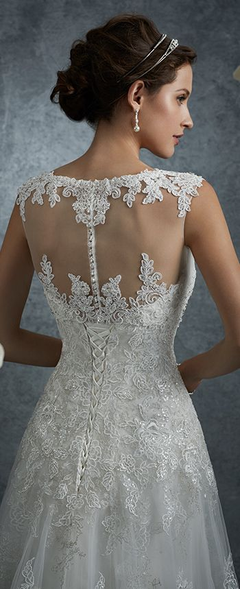 Y217JKT - Misty tulle and beaded lace appliqué bolero jacket with slight cap sleeves, lace bateau neckline and center back diamante button closures.