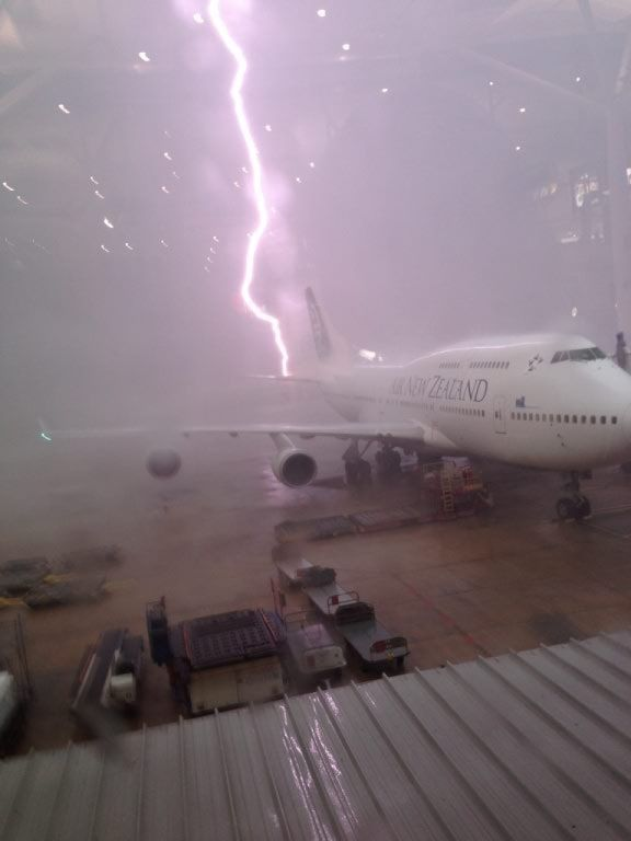 Incredible photo of lightning striking an Air New Zealand 747 at Brisbane International Airport.