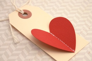 Inspiration: mercantile label with cardboard heart stitched on. The link doesn't work, but the photo is clear enough.