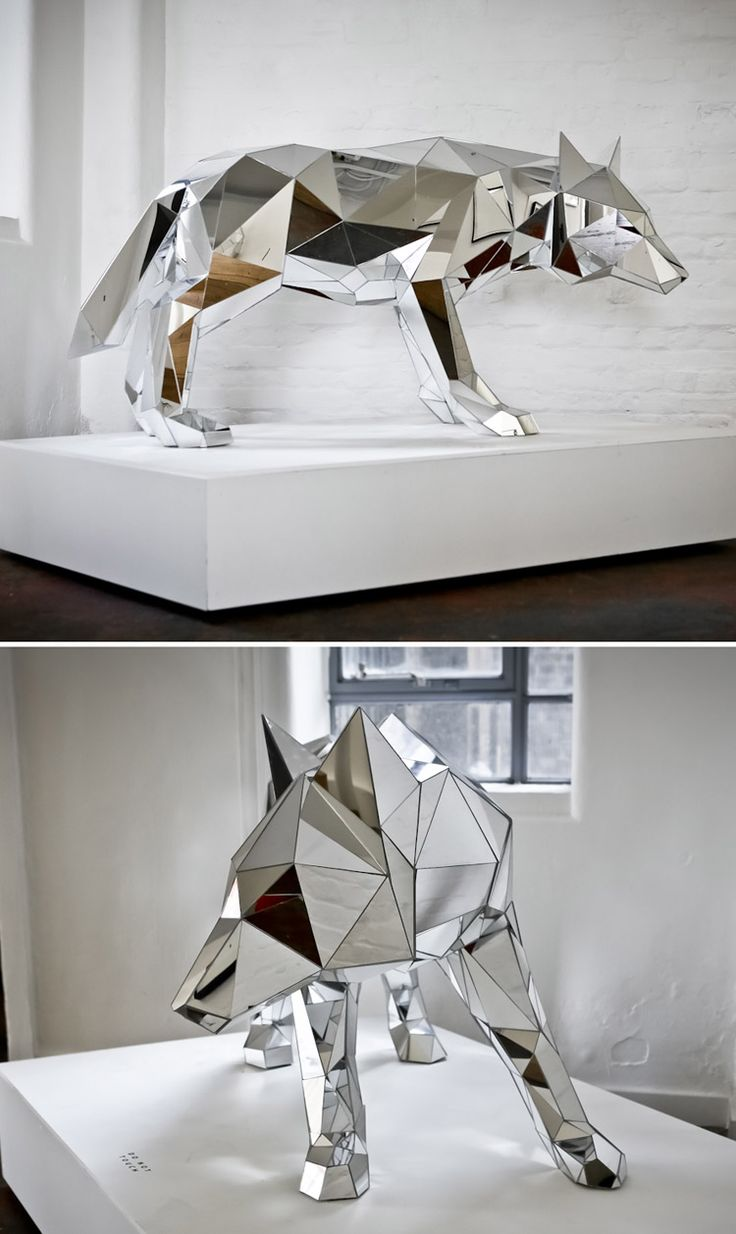 Mirrored wolf sculpture, Arran Gregory.  I chose this sculpture as it provides organic and geometric themes that shows a abstract wolf... I also like the fact it is mirrored giving the effect that it's surroundings change it's a appearance.
