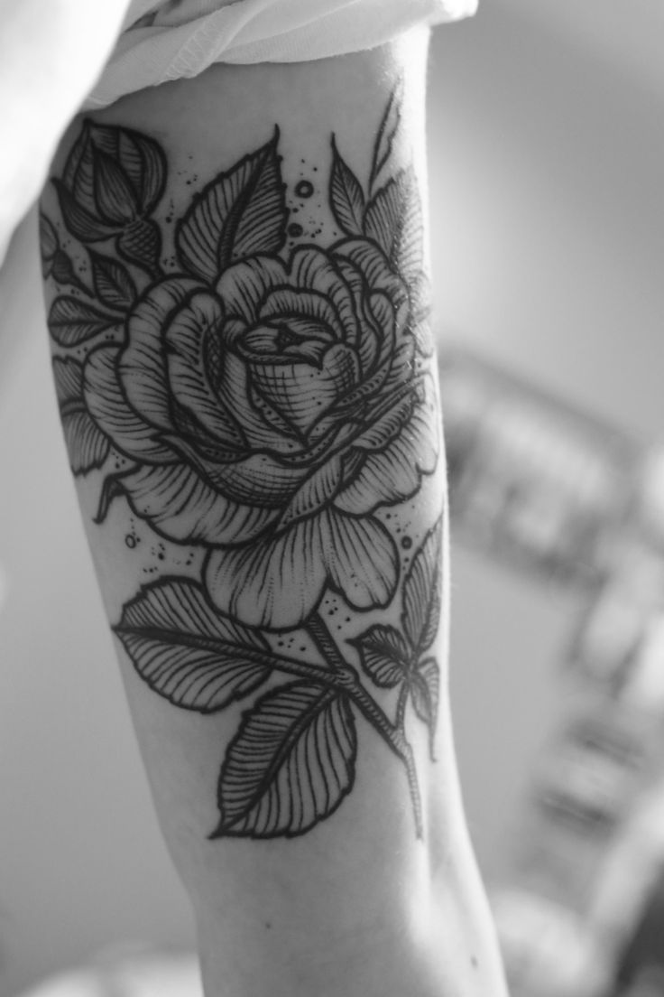beautiful black and white rose tattoo on arm. Love it!