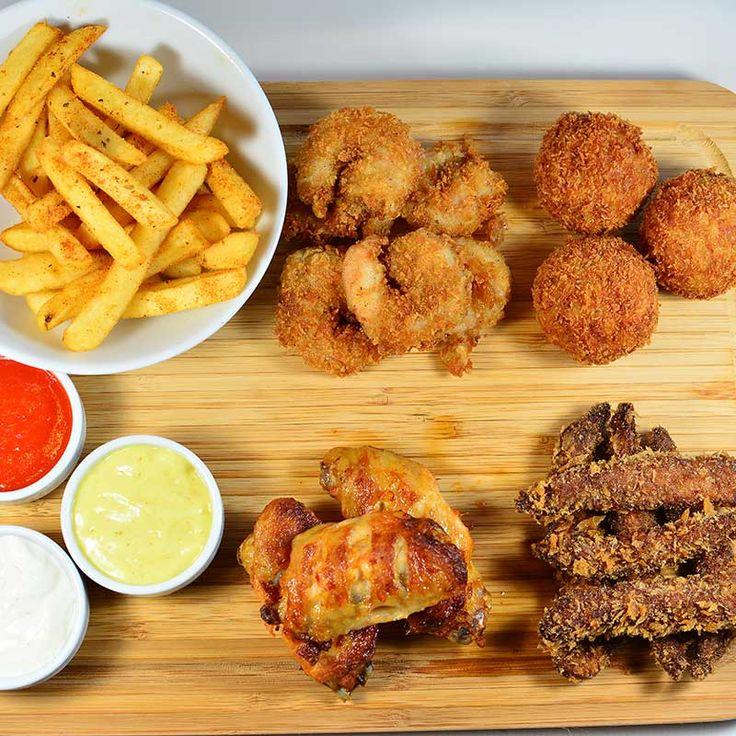 Risotto topları, tempura karides, barbekü kanat, çıtır piliç ve baharatlı çips