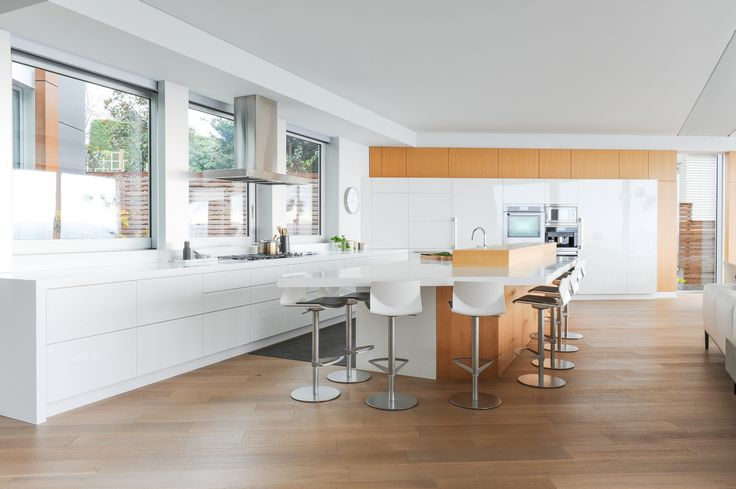 This modern white kitchen is designed by FNDA Architecture.