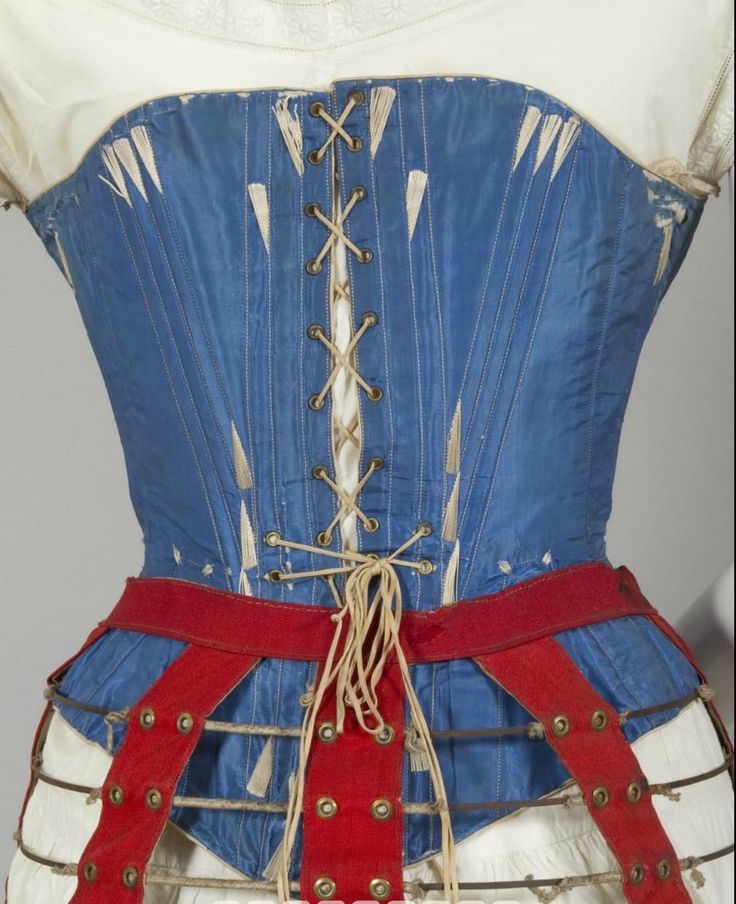 1860s blue silk corset. Steel bones and busk, brass hardware, cream cotton sateen lining, cotton lace at top. Powerhouse Museum (Australia), but purchased in England. [jrb]