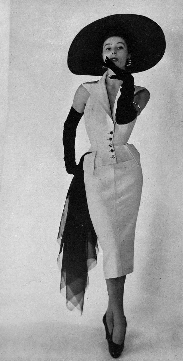 Bettina in tailored white alpaca cocktail dress by Jacques Fath, photo by Georges Saad, 1950