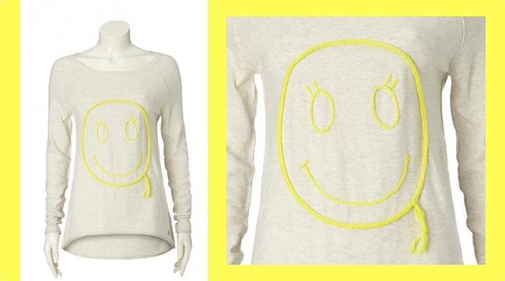 Wil je zelf het zonnetje binnen halen? Deze smiley trui helpt wel!