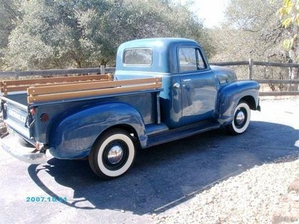 If I ever win the lottery.....A blue 1951 Chevy truck with wood side rails.
