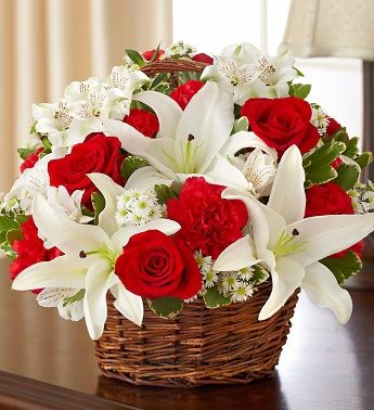 Peace, Prayers & Blessings - Red and White - Send Fresh Flowers Internationally   Send a little bit of heaven on earth with this peaceful red and white sympathy bouquet. A serene basket arrangement of roses, lilies, alstroemeria and carnations is accented with a pair of elegant dove picks to offer a comforting tribute during times of sorrow.