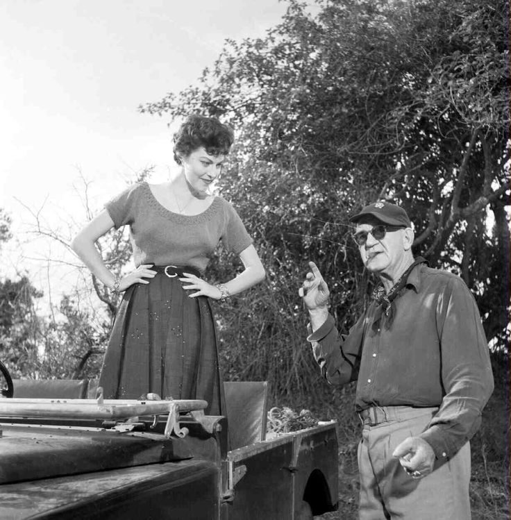 Ava Gardner and director John Ford behind the scenes of Mogambo (1953)