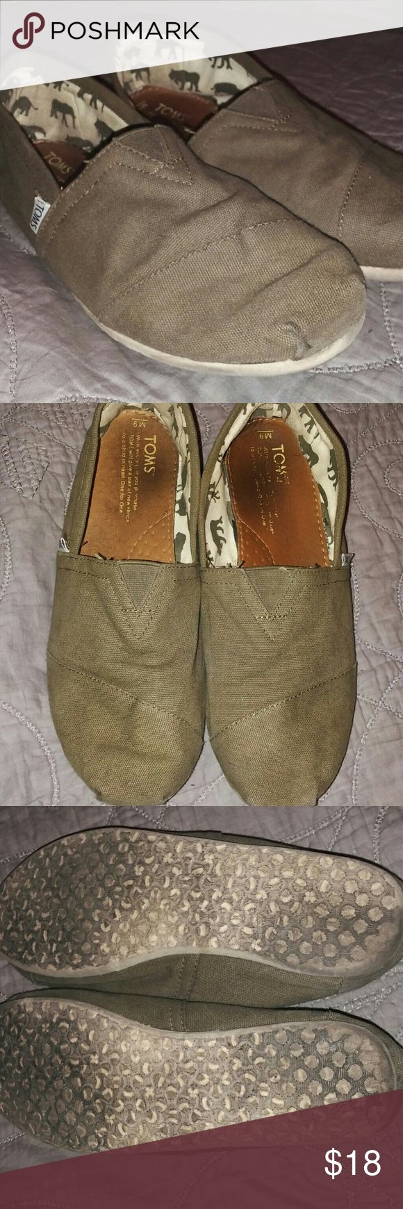 Olive Green Men Toms These have been worn a few times and you can see some wear inside but the outside of the shoes look in great condition! Size 9 men's slip on Toms Toms Shoes Sneakers