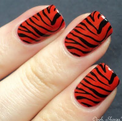 red/black tiger stripes  I personally would choose a different color...hmmmm silver/purple perhaps.