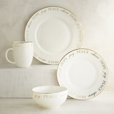Our holiday dinnerware set has a lot to say—delicate seasonal words that trim the edges of each plate, bowl and mug. It instantly fills your annual dinner party with joy and cheer and elegant holiday style.