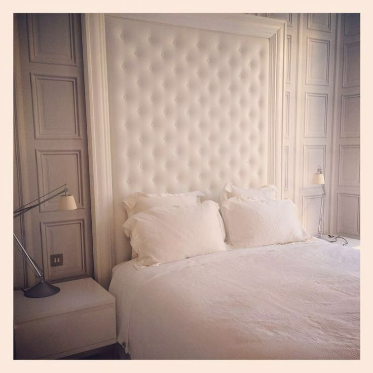 Beautiful deep buttoned white leather headboard with white wooden surround.