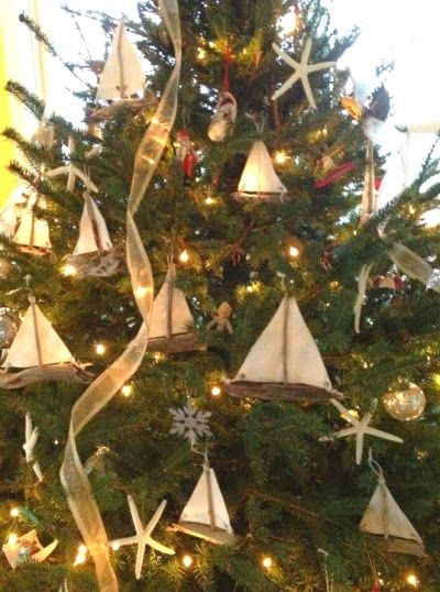 This is one of my favorite nautical Christmas trees.  I love the driftwood sail boats.