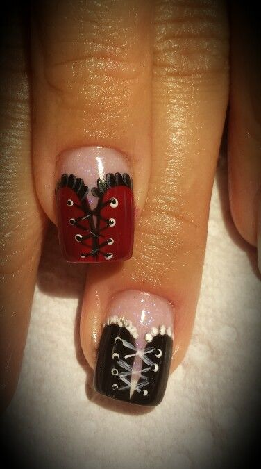 So cute red and black corset nails