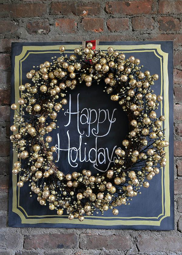 We love this LED gold wreath from The Home Depot displayed on a chalkboard with a holiday message. It's part of the glam/rustic Christmas look styled by Ginnie Leeming of Hello Little Home. See how she made this, on The Home Depot Blog. || @ginniel