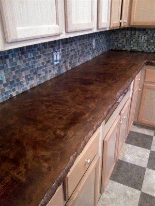 I like the uneven edge of the counter top here. Concrete Stain - but with air stone for the backsplash.