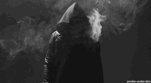 Unseen figure in a hoodie - smoke coming out - gif