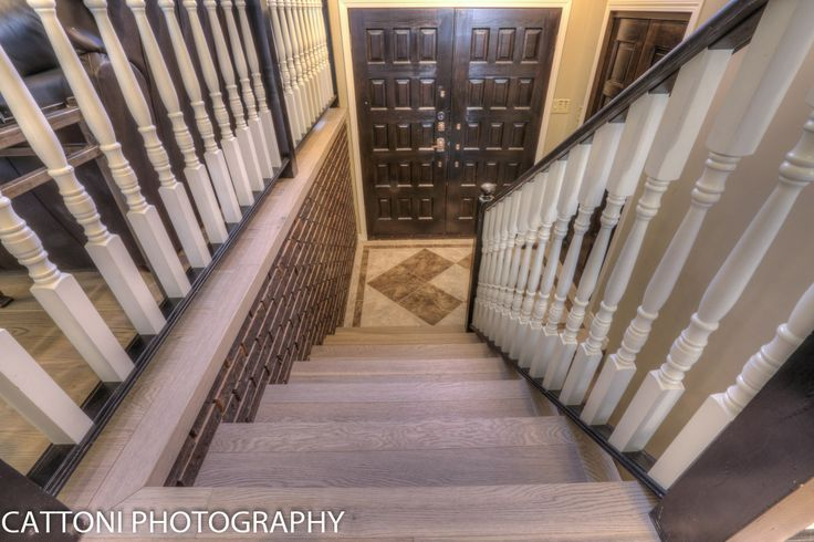 The stairs of this beautiful Home features Lauzon Flooring Fifth Avenue Wire Brushed hardwood flooring from the Urban Loft Series. #interiordesign #hardwoodfloor #artfromnature #entry #hall #stairs