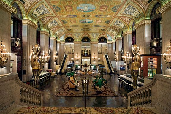 The Palmer House's grand lobby boasts a remarkable ceiling. The two winged statues in the foreground were created by Louis Comfort Tiffany.