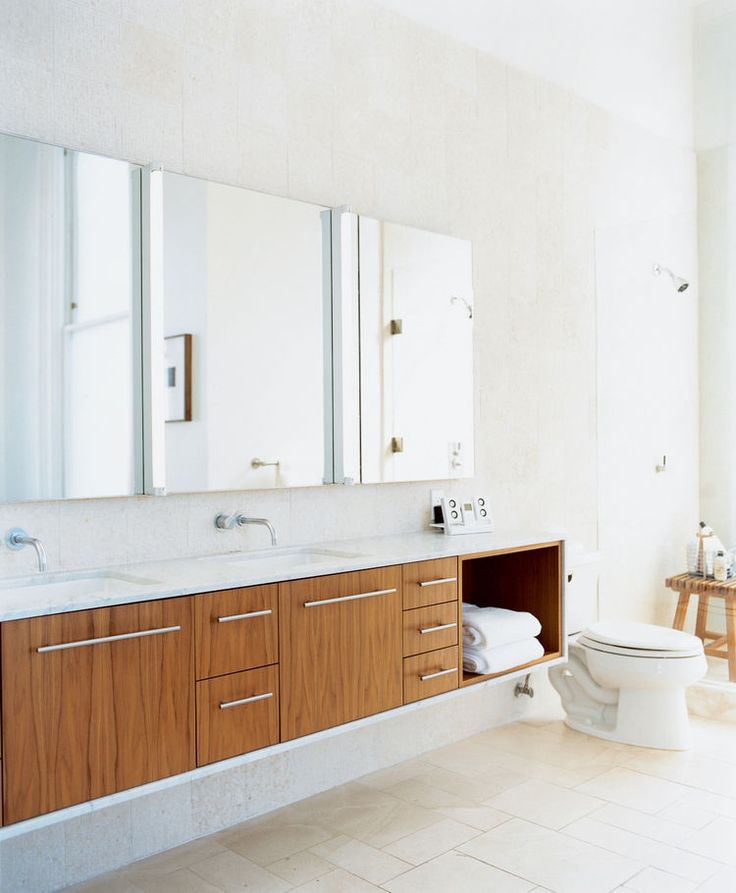 The master bathroom used to be a tiny kitchen in what was once a tiny apartment. The cabinets were designed by Nilus de Matran and fabricated by George Slack.