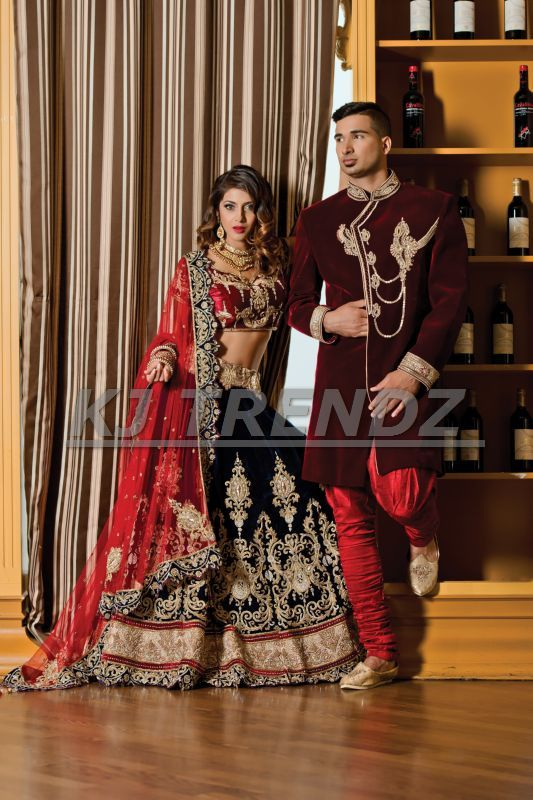 SHOW THAT YOU ARE ROYALTY WHILE WEARING A MAROON VELVET SHERWANI MATCHING THE NAVY BLUE AND RED LEHENGA.