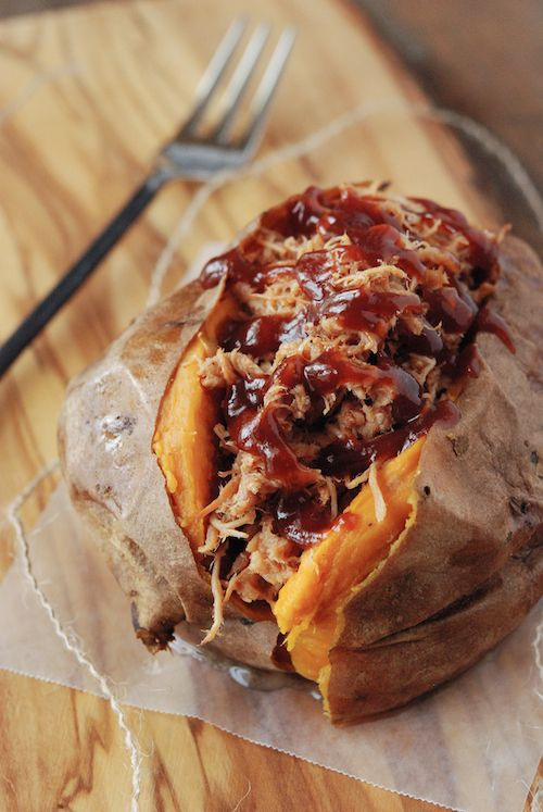 Pulled pork stuffed sweet potatoes  #paleo  Although it is paleo, it needs to be cleaned up a bit...too much sugar in BBQ sauce
