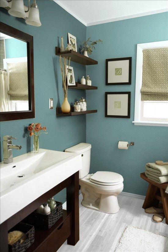 """Hit """"Visit"""" to find where to get the decor and fixtures in this contemporary blue bathroom. www.reacreatearoom.com"""
