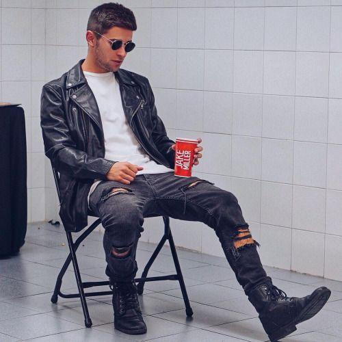 Simplr • Jake Miller in a black leather biker jacket and...