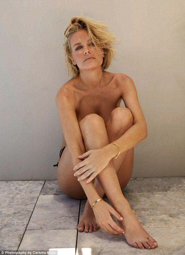 Naked ambition! Lara Bingle sheds her clothes to pose topless in string bikini bottoms as ...