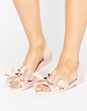 On SALE at 29% OFF! Seduction Bow Shoe by Melissa. Shoes by Melissa, Recyclable plastic upper, Subtle bubblegum scent, Slip-on style, Two-part design, Peep toe, Cushion...