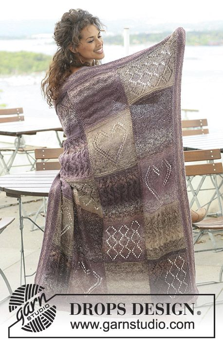 Heart's Desire / DROPS 124-20 - Knitted DROPS blanket in Delight and Alpaca with squares in different textured patterns.