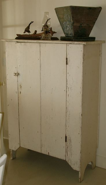 primitive cabinet in old paint