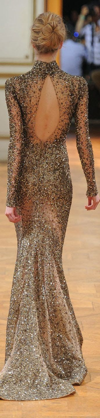 Gorgeous Embroidered Gown w/ small trail, key hole back & mock turtleneck, long sleeves. Sequins, crystals, beads hand sewn onto a fine mesh or organza?