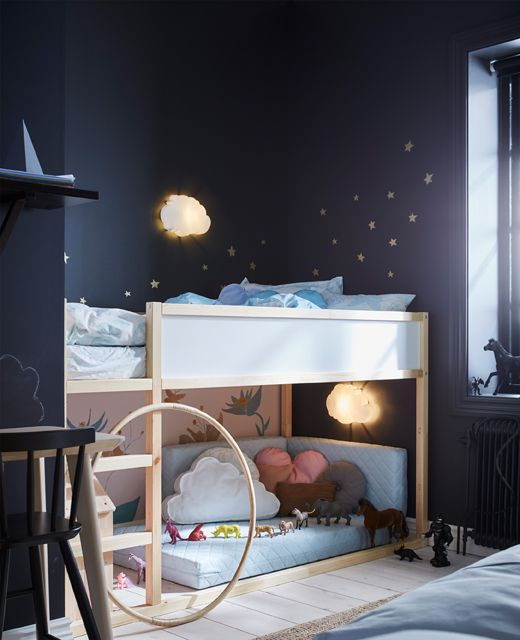 A child's area in a shared bedroom with a reversible loft bed that has sleeping space on top and a play area underneath