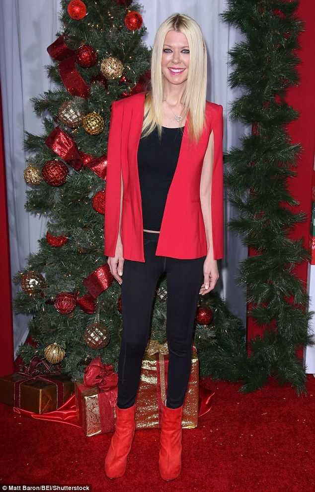 Rocking red: Tara Reidadded some holiday cheer to her black ensemble with a red cape blaz...