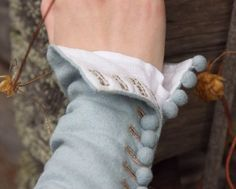 kirtle - buttons on the bottom edge