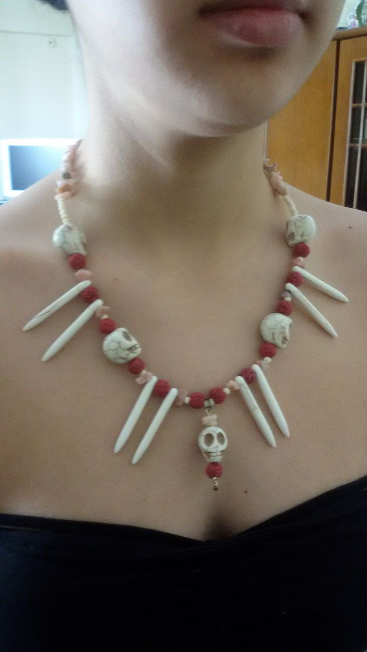 Voodoo - ethnic necklace with skulls and teeth from chaοliti and beads from red lava.