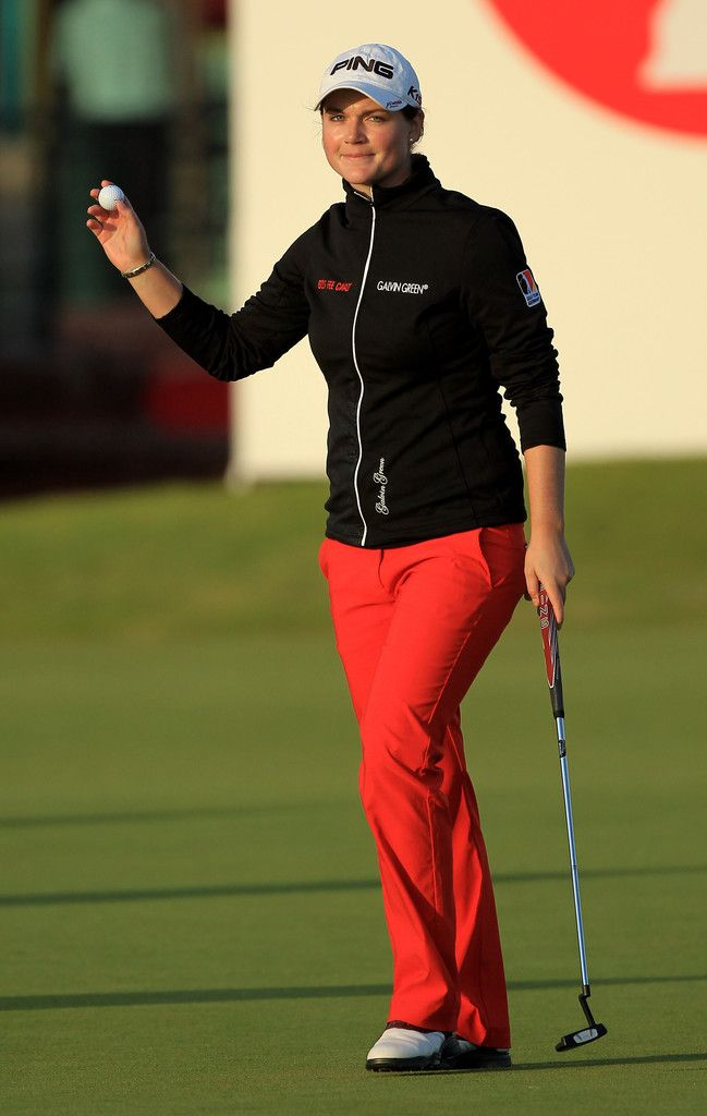 Caroline Masson Photos Photos - Caroline Masson of Germany acknowledges the crowd on the 18th hole during the second round of the 2011 Ricoh Women's British Open at Carnoustie on July 29, 2011 in Carnoustie, Scotland. - Ricoh Women's British Open - Day Two