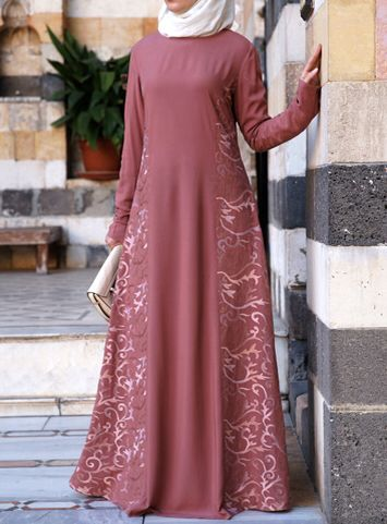 Arabesque Embroidered Gown Rose Dawn color Every little girl dreams of being a princess, and this gown embodies the fantasy in a classic and elegant way. The billowy, loose nature provides fluidity and ease of movement for a modest look. The combination of the demure and graceful style with an intricate motif makes it the perfect choice for your magical ball.  Note: All our Gowns are slimmer fitting in the upper body and sleeves compared to normal SHUKR dresses and abayas. They are…